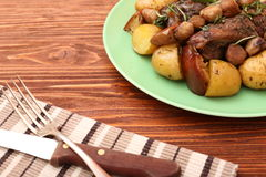 Beef roasted with potatoes, chestnuts, apples Royalty Free Stock Images