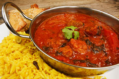 Beef rogan josh in balti dish with rice Royalty Free Stock Photos
