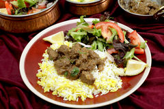 Beef rogan josh dinner with bowls Royalty Free Stock Image