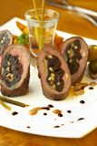 Beef rolls with prunes, cheese and pine nuts Stock Photos