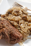 Beef roulade with cabbage. Beef roulade with cabbage on a white plate. Selective focus Stock Photography