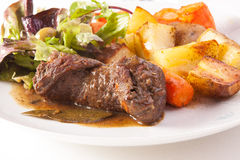 Beef roulade. With potatoes and salad royalty free stock photo