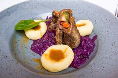Beef roulade staffed with mushrooms in creamy mushroom sauce served with boiled baby potatoes stock photography