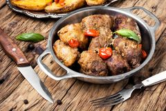 Beef roulades in a metal bowl royalty free stock photo