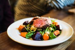 Beef salad with quinoa and baked vegetables. Beef salad with quinoa and baked root vegetables Royalty Free Stock Photo