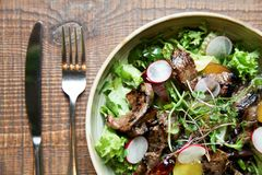 Beef salad with radish, peach and green vegetables stock photos