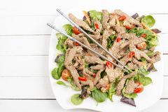 Beef salad with sesame seeds Royalty Free Stock Photography