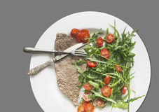 Beef with salad and tomatoes, dietetic food Stock Photos