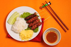 Beef salad Vietnam style. Vietnam beef on sticks served with salad with an orange background Stock Images