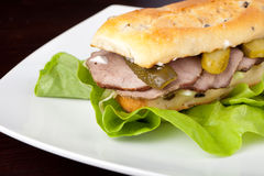 Beef Sandwich. On a white plate Royalty Free Stock Photo