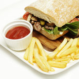Beef sandwich and french fries Royalty Free Stock Images