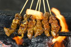 Beef Satay. Is a traditional southeast asian food which is very popular especially in Malaysia and Indonesia. The marinated beef is grilled over charcoal fire stock image