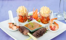 Beef Satay skewer appetizer canape and peanut sauce. Beautiful arrange on white plate Stock Photo