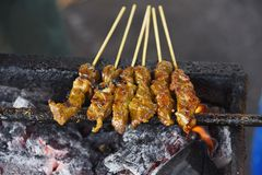 Beef Satay. Is a traditional southeast asian food which is very popular especially in Malaysia and Indonesia. The marinated beef is grilled over charcoal fire stock photos