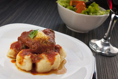 Beef with sauce and gnocchi Stock Photos