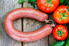 Beef sausage on wooden background Stock Photo