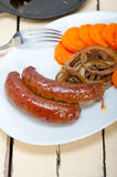Beef sausages cooked on iron skillet Stock Images
