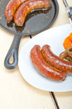 Beef sausages cooked on iron skillet Stock Image