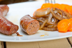 Beef sausages cooked on iron skillet Royalty Free Stock Photography