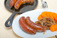 Beef sausages cooked on iron skillet Royalty Free Stock Photo