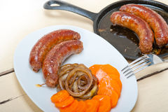 Beef sausages cooked on iron skillet Stock Photos
