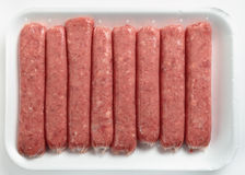Beef sausages on a polystyrene tray Royalty Free Stock Images