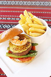 Beef and seafood burger with fries Royalty Free Stock Images