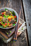 Beef in sesame served with vegetables and noodles Royalty Free Stock Photo