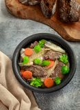 Beef and shallot stew. With carrot above view royalty free stock image