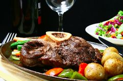 Beef shank. Juicy beef shank served on a sizzling iron plate stock photography