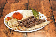 Beef Shish Kebap on Plate. Beef shish kebap on wooden table background Stock Images