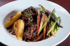 Beef short ribs. With seasonal vegetables stock image
