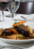 Beef short ribs. In gravy with stewed carrots, potatoes, and onions stock images