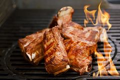 Beef short ribs on bbq grill. Beef short ribs on bbq flame grill stock photography