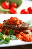 Beef with shrimp. Delicious oven beef with shrimp and tomatoes Royalty Free Stock Images