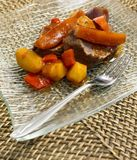 Beef with side-dish. From one pot Royalty Free Stock Images