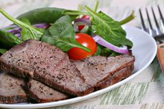 Beef sirloin and spinach Royalty Free Stock Photography