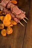 Beef skewer and apricots Stock Photos