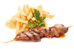 Beef skewers with french fries Royalty Free Stock Photography