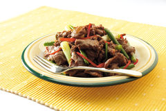 Beef slices. A plate of oriental style stir-fried beef Stock Photos