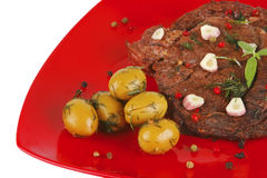 Beef slices on red dish Stock Photos