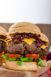 Beef Sliders with homemade barbecue sauce. Cheddar, cherry tomatoes and microgreens Royalty Free Stock Photography
