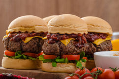 Beef Sliders with homemade barbecue sauce. Cheddar, cherry tomatoes and microgreens Royalty Free Stock Image