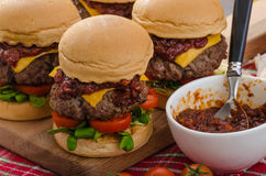 Beef Sliders with homemade barbecue sauce. Cheddar, cherry tomatoes and microgreens Stock Image