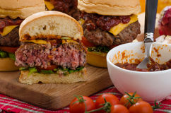 Beef Sliders with homemade barbecue sauce. Cheddar, cherry tomatoes and microgreens Royalty Free Stock Photo