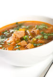 Beef soup. In a white bowl Stock Photo