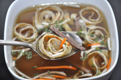 Beef Soup. Home-made german beef soup with pancake strips Stock Photos