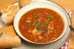 Beef Soup with Crusty Bread. Spicy beef soup with lentils, kidney beans and chilli Royalty Free Stock Photo