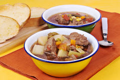 Beef Soup. Served with buttered toasted crusty italian bread. Soup ingredients are potatoes, mixed vegetables, low sodium beef broth, onions, celery, garlic and Royalty Free Stock Photo