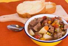 Beef Soup and Toasted Buttered Italian Bread Stock Photo